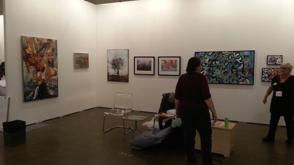 Frances Patella and Gwen Tooth are installing Propeller's booth at Art Toronto, October, 2014. Courtesy of Propeller Art Gallery