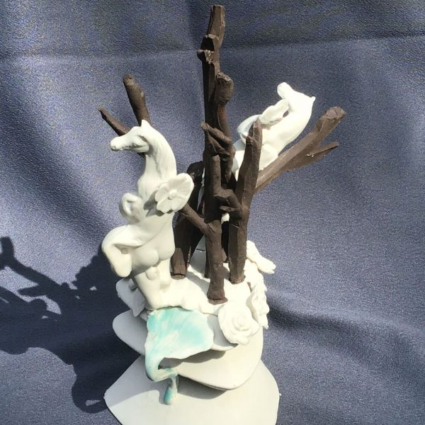 """Ann Cummings, Tree of Life, Porcelain Clay and Black Clay, 10"""" x 4"""", $700"""